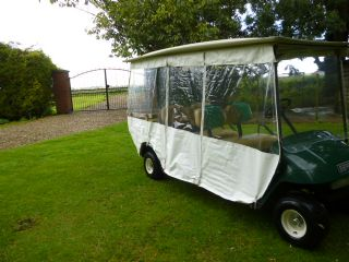 SOLD!!! EZGO TRANSPORTER 4 SEATER WITH CARGO