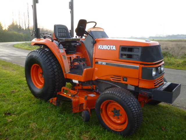 SOLD!!! KUBOTA ST30 COMPACT TRACTOR WITH DECK